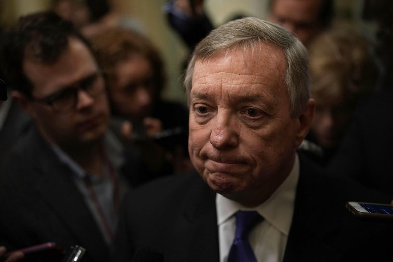 Senate Minority Whip Sen. Dick Durbin speaks to members of the media on Jan. 23 in Washington.