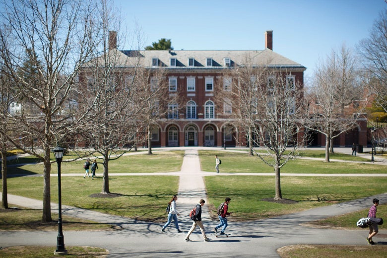 Students walk on paths that stretch out in front of Phillips Exeter Academy.
