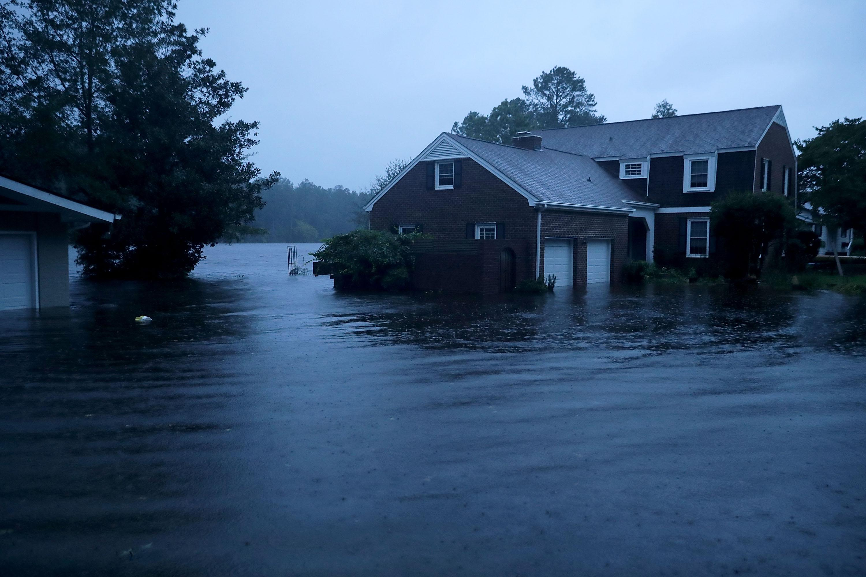 The Trent River (background) overflows its banks and floods a neighborhood during Hurricane Florence September 13, 2018 in River Bend, North Carolina. Some parts of River Bend and the neighboring New Bern could be flooded with a possible 9-foot storm surge as the Category 2 hurricane approaches the United States.  (Photo by Chip Somodevilla/Getty Images)