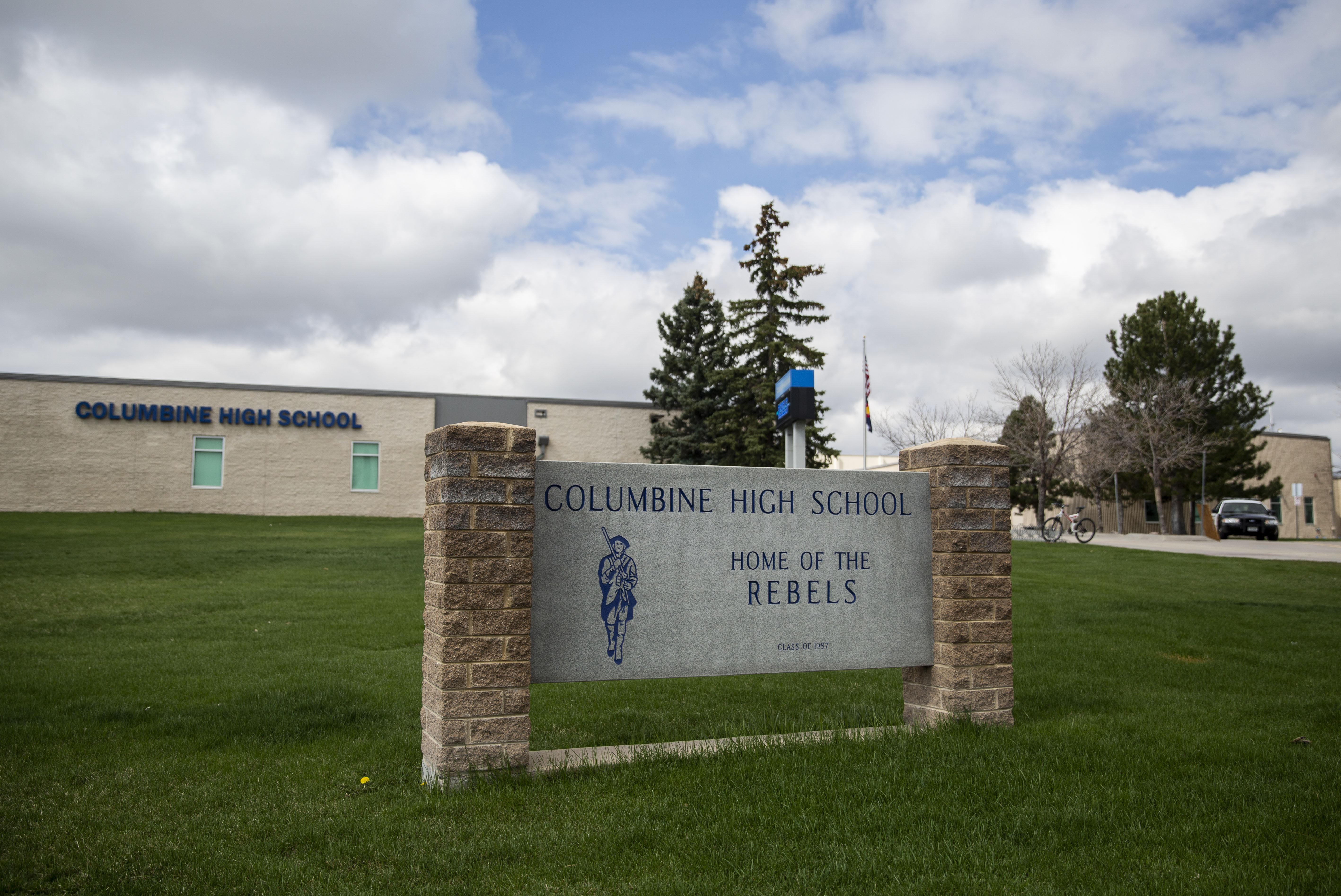 A police car can be seen outside Columbine High School.