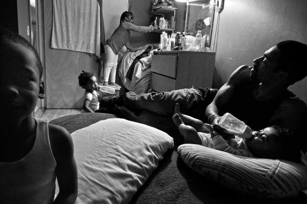 Bronx, NY. 2012. Guy Miller keeps a watchful eye on his children Nijeyah, Nijel, Guy Jr., and Lanae.