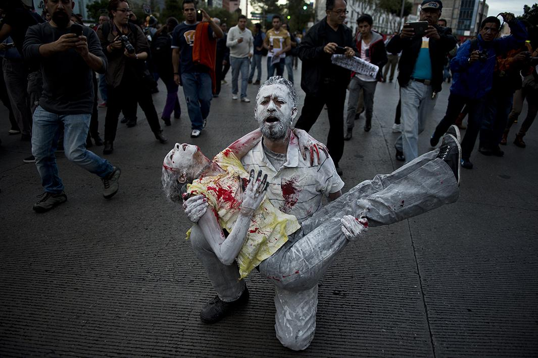 People take part in a march in Mexico City demanding justice for the 43 missing students on October 22.