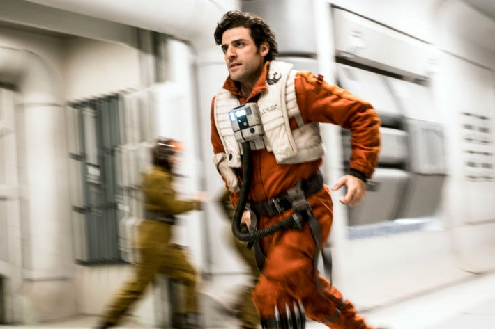 A still from the film of Poe Dameron (Oscar Isaac) running through the Resistance ship to board his  X-wing.
