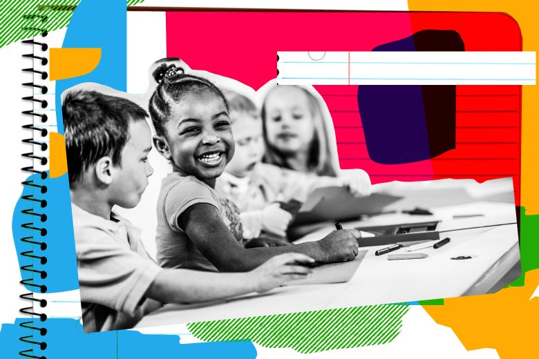 Grinning girl sitting at a table with other kids at preschool