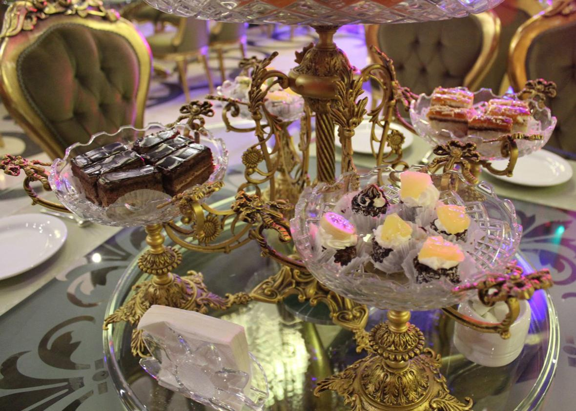 The female party starts with petit fours: they provide the much needed energy for the frantic dancing that will soon follow. The main meal will only be offered after the party has quieted down. Photo: Tacita Vero