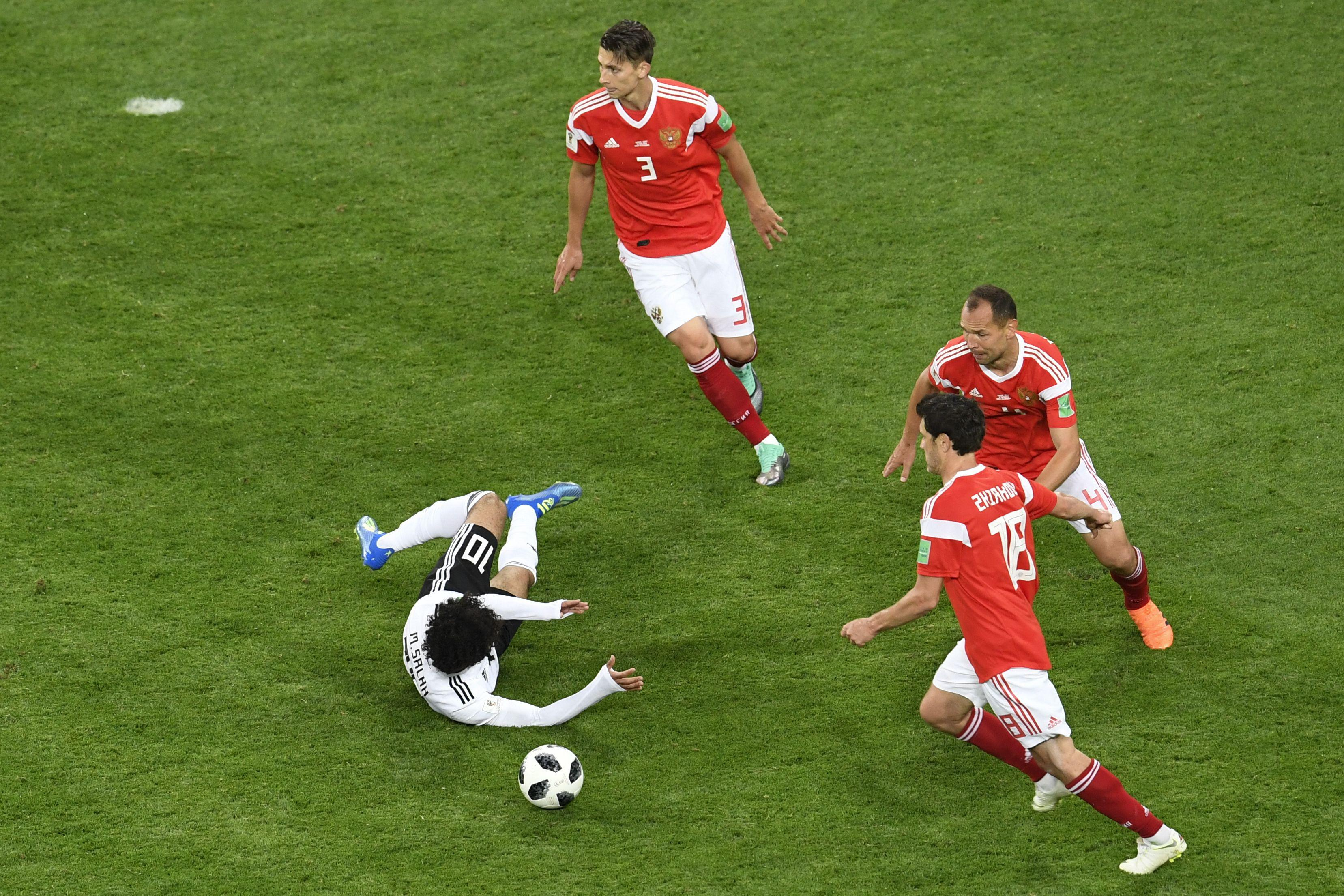 Egypt's forward Mohamed Salah falls to the ground after being fouled during the World Cup.