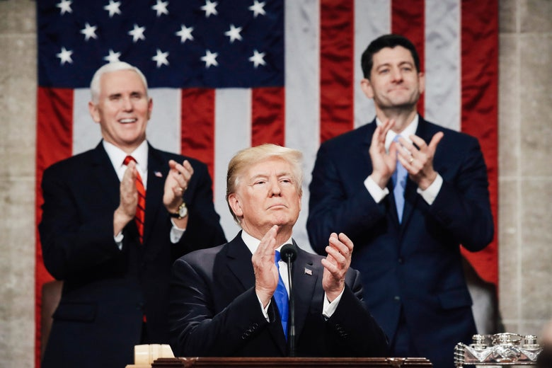 U.S. President Donald J. Trump claps along with U.S. Vice President Mike Pence (L) and Speaker of the House U.S. Rep. Paul Ryan (R-WI) (R) during the State of the Union address.