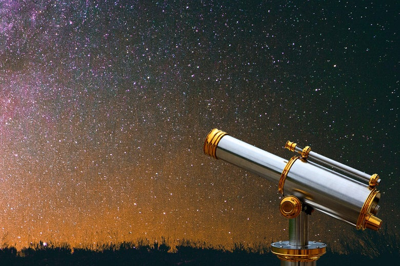 A telescope looking at a starry night sky.