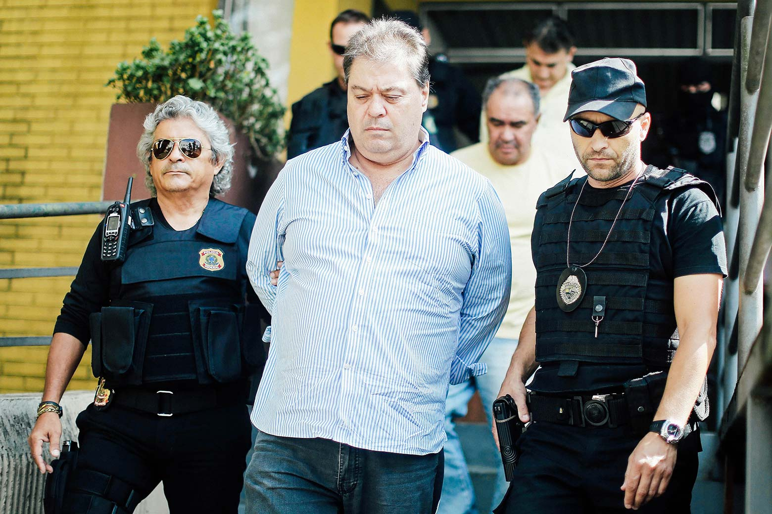 Former Sen. Gim Argello is escorted.