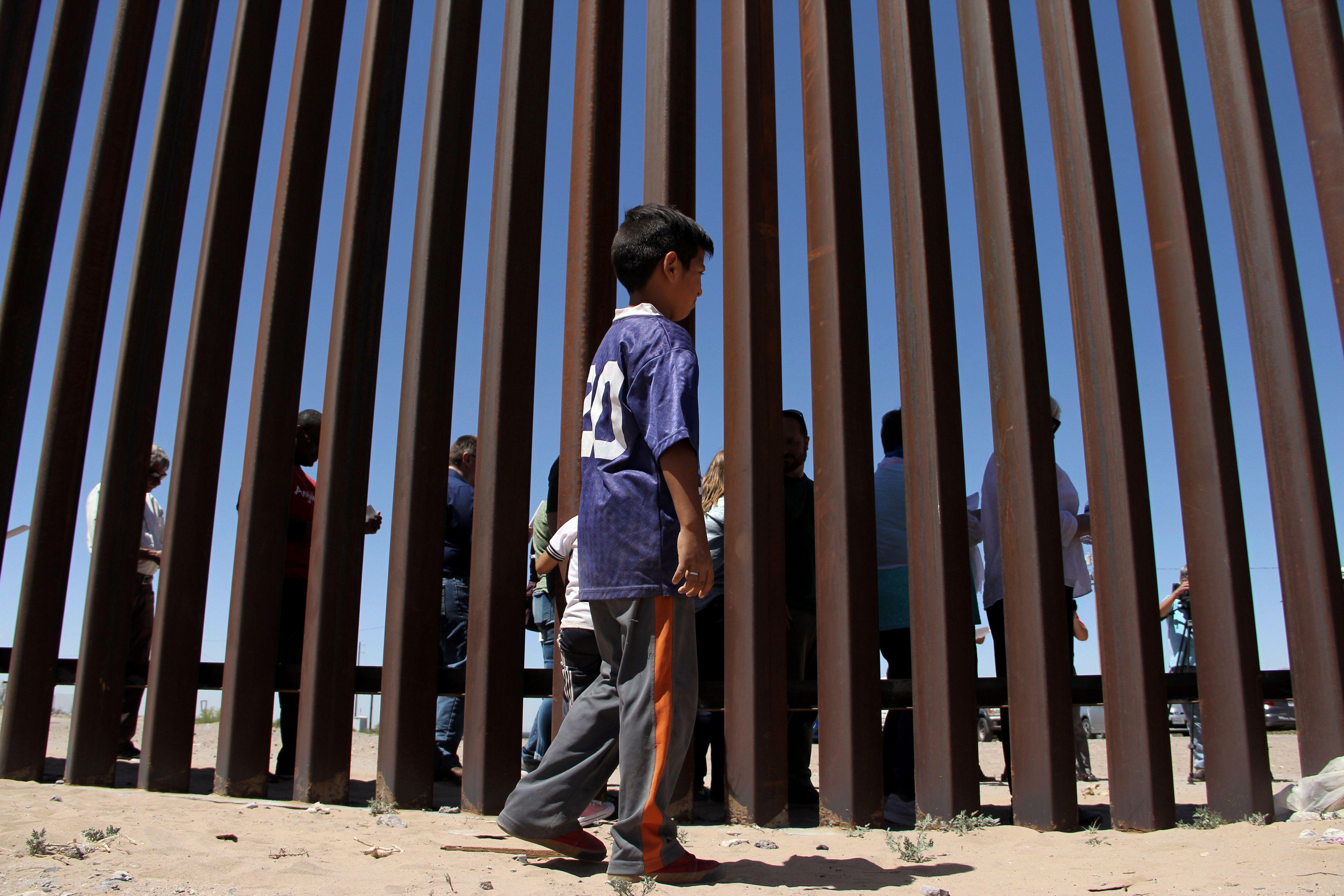 A boy at the border wall.
