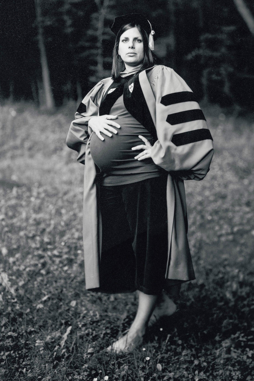 Julie poses in graduation regalia.