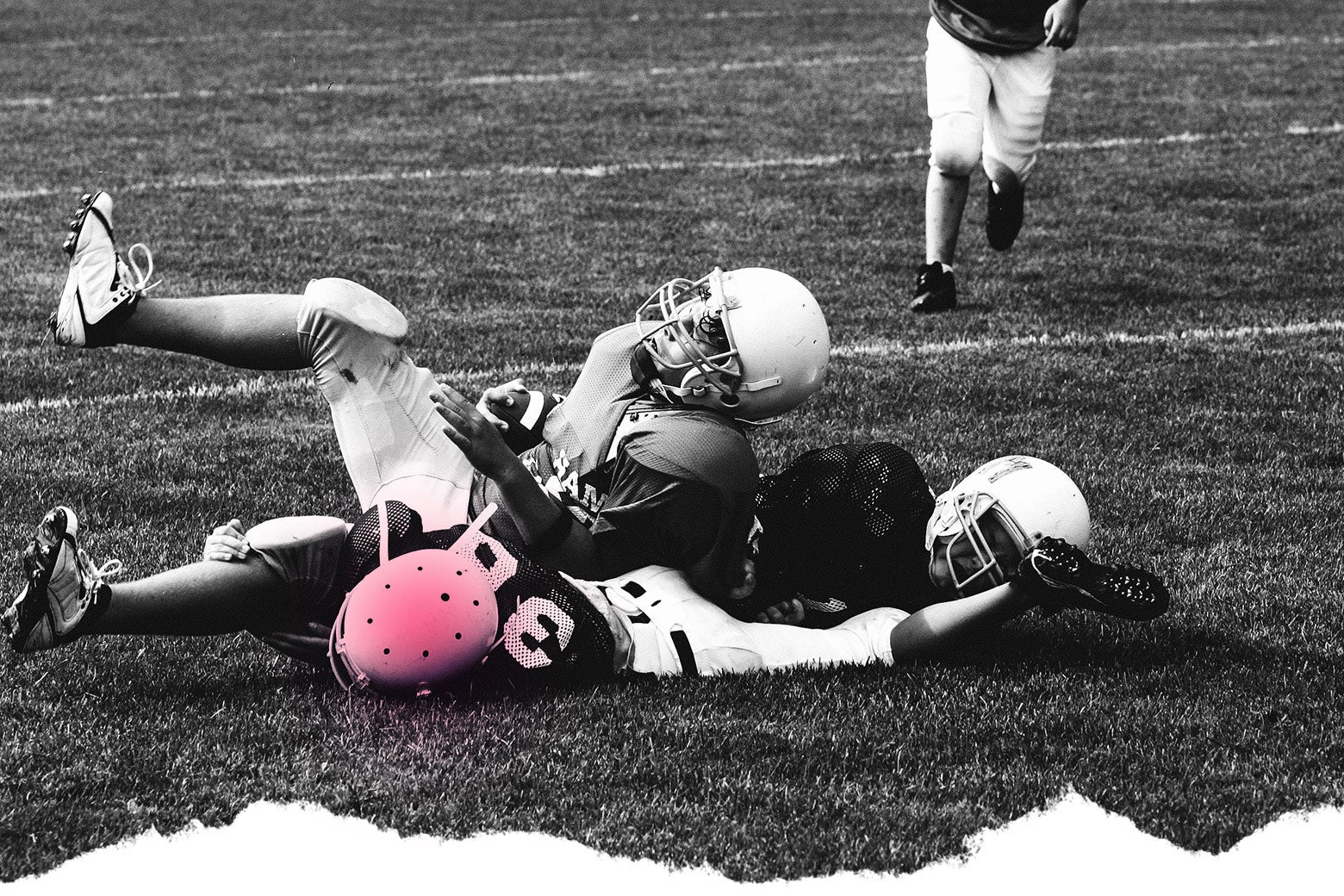 Photo illustration: A football player lies on the ground with his helmet highlighted to suggest a possible concussion.