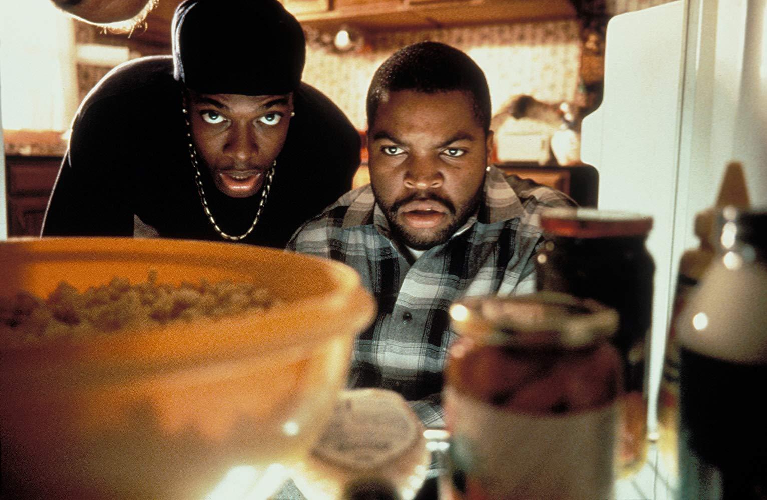 Chris Tucker and Ice Cube look into a fridge.