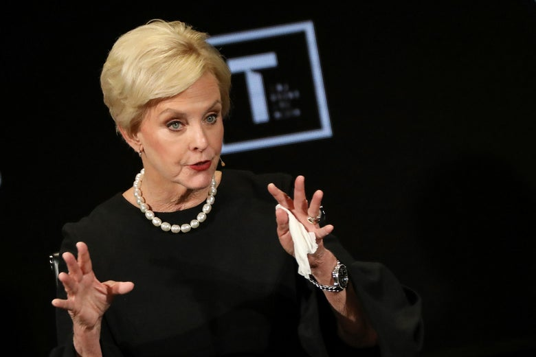Cindy McCain gestures with both hands while speaking onstage