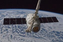 Dragon grappled by the ISS