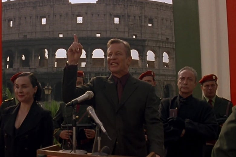 Michael York, as the antichrist, gives a speech in front of the Roman coliseum.