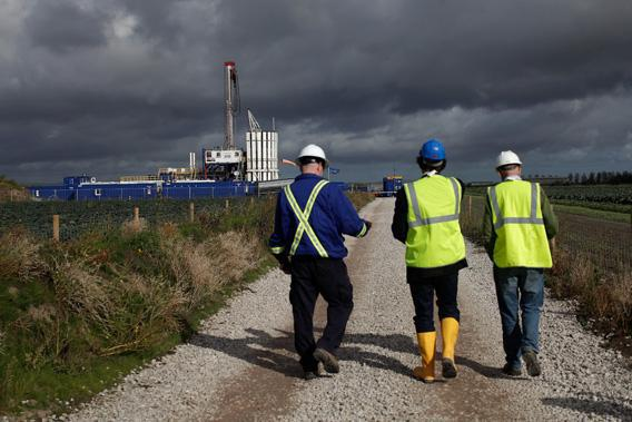 Engineers look at the Cuadrilla shale fracking facility on October 7, 2012 in Preston, Lancashire.