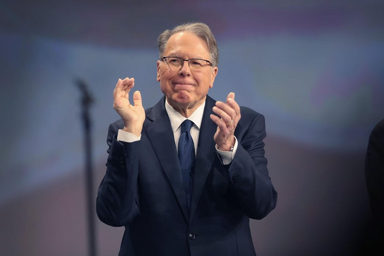 NRA CEO Wayne LaPierre claps at an NRA event.