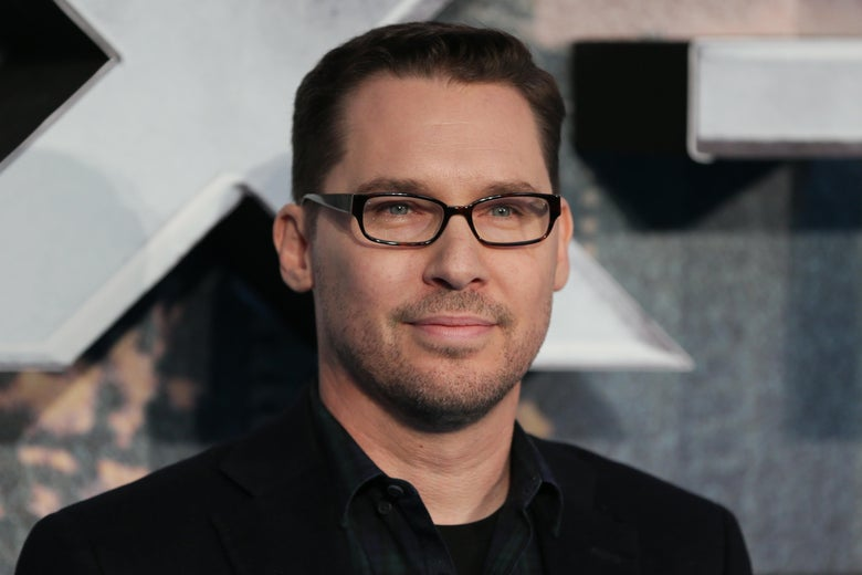 Bryan Singer poses on arrival for the premiere of X-Men Apocalypse.