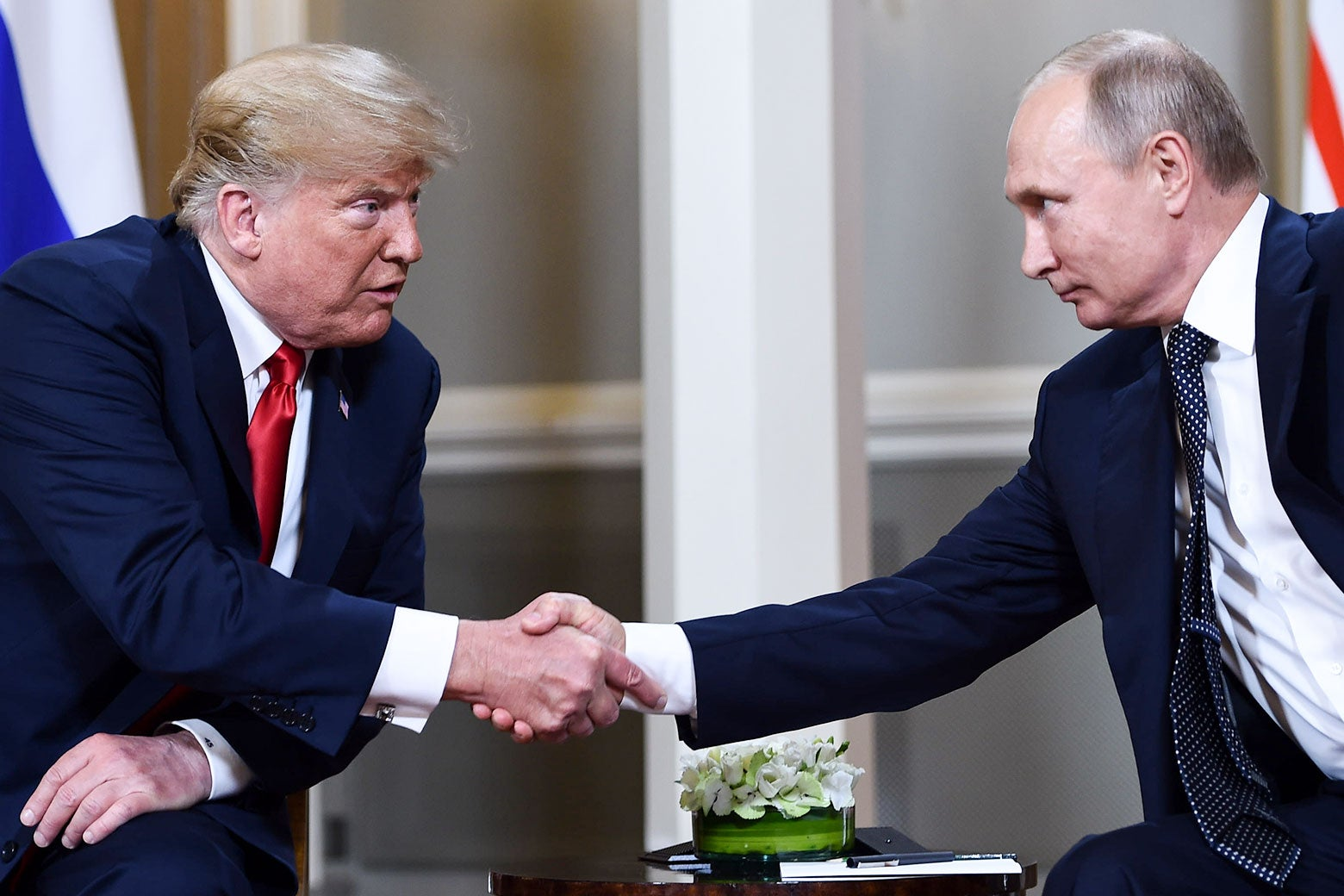President Donald Trump and Russian President Vladimir Putin shake hands in Helsinki on July 16.