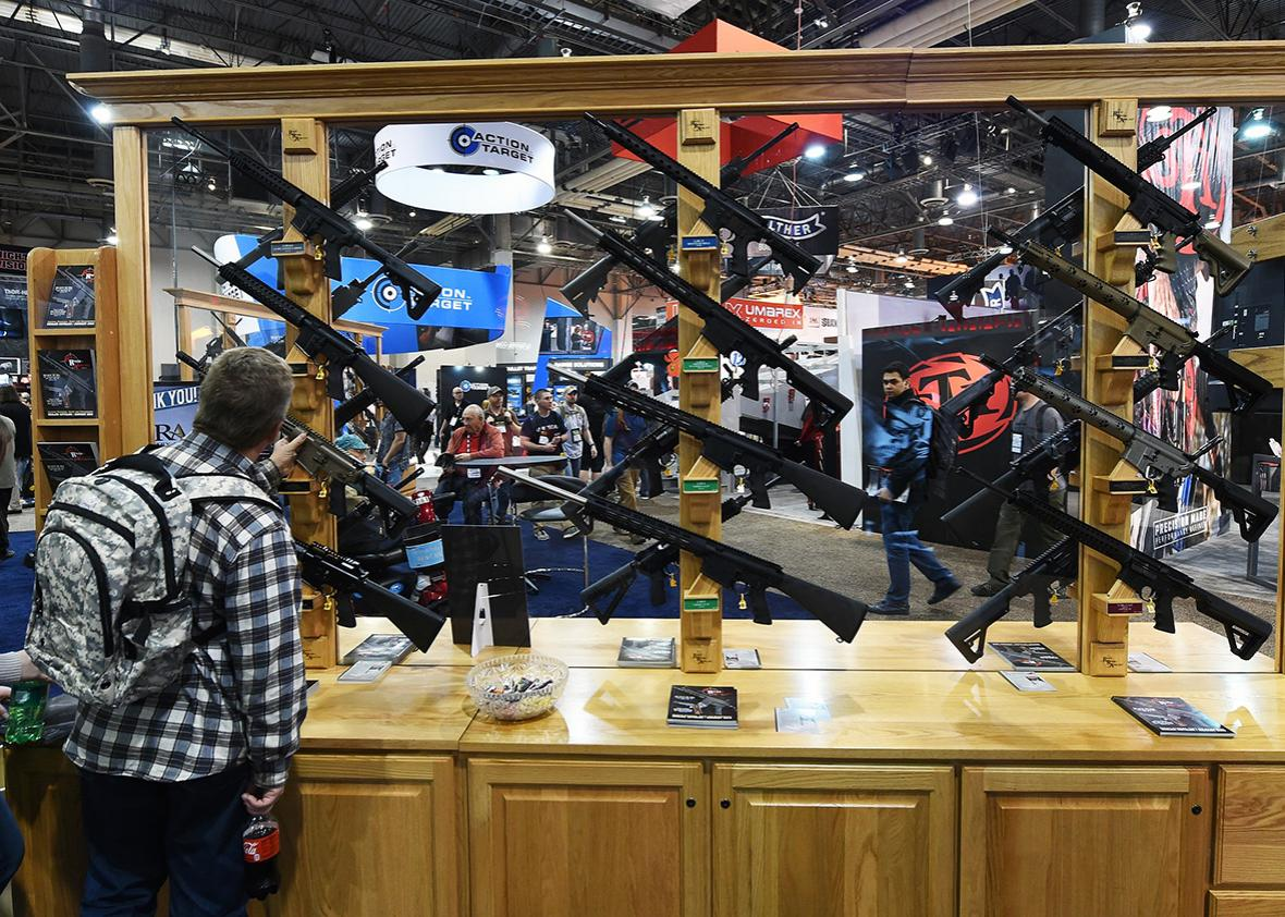 A convention attendee looks at rifles displayed at the Rock River Arms booth at the 2016 National Shooting Sports Foundation's Shooting, Hunting, Outdoor Trade Show at the Sands Expo and Convention Center on January 19, 2016 in Las Vegas, Nevada.