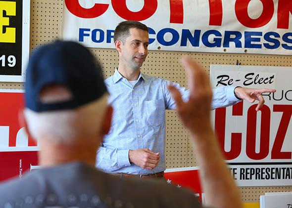 Rep. Tom Cotton looks for questions in a crowd of supporters at a Republican.