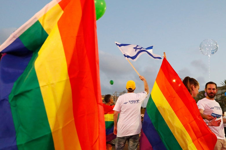 Participants attend a demonstration in Tel Aviv on July 22, 2018, to protest a new surrogacy law that does not include gay couples.