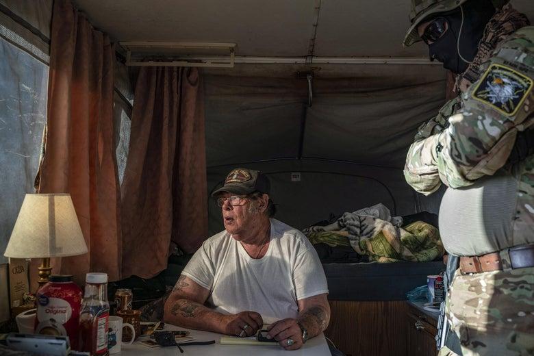 Hopkins sits in a camper.