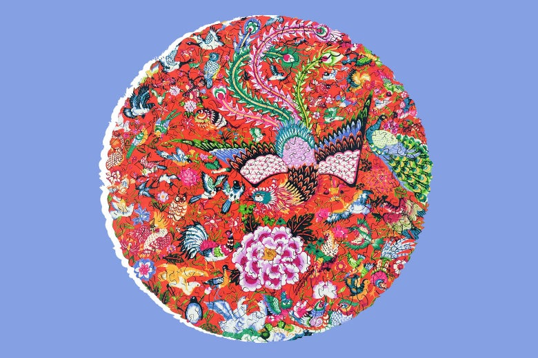 A circular jigsaw puzzle with a flower and phoenix design