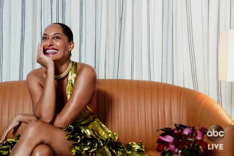 Tracee Ellis Ross sits on a couch during the Emmy Awards