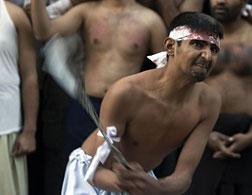 Pakistani Shiites flagellate themselves during Ashura. Click image to expand.