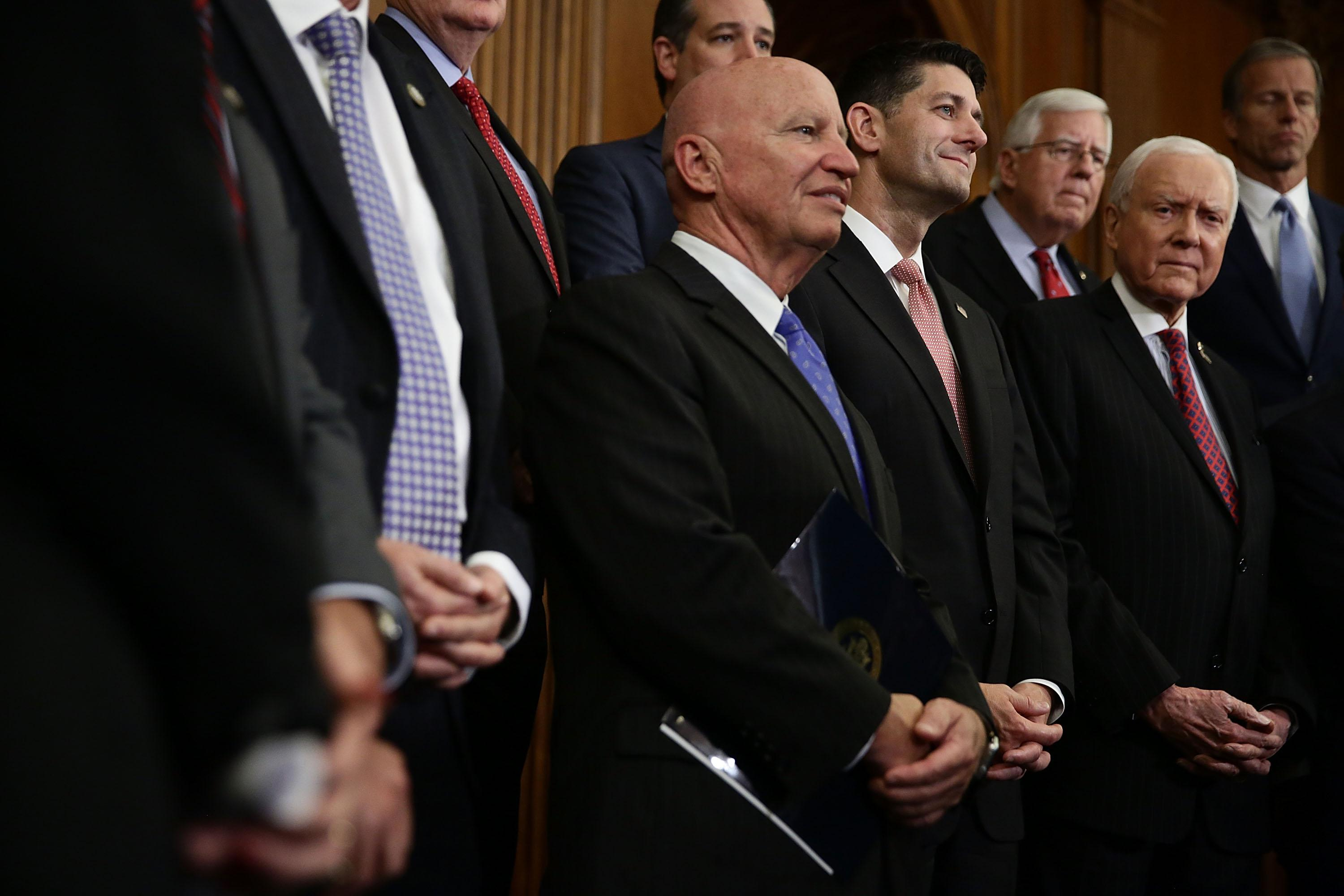 WASHINGTON, DC - SEPTEMBER 27:  (L-R) U.S. Rep. Kevin Brady (R-TX), Speaker of the House Rep. Paul Ryan (R-WI), Sen. Orrin Hatch (R-UT), Sen. Michael Enzi (R-WY) and Sen. John Thune (R-SD) listen         during a press event on tax reform September 27, 2017 at the Capitol in Washington, DC. On Wednesday, Republican leaders proposed cutting tax rates for the middle class, wealthy and businesses. Key questions remain on how they plan to offset the trillions of dollars in lost tax revenue.Ê  (Photo by Alex Wong/Getty Images)
