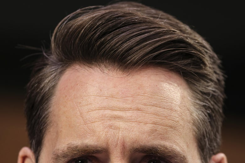 An extreme close up of Josh Hawley's eyes and well-coiffed hair.