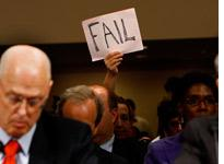 """A demonstrator holds a """"fail"""" sign at a Senate hearing on the financial crisis. Click image to expand."""