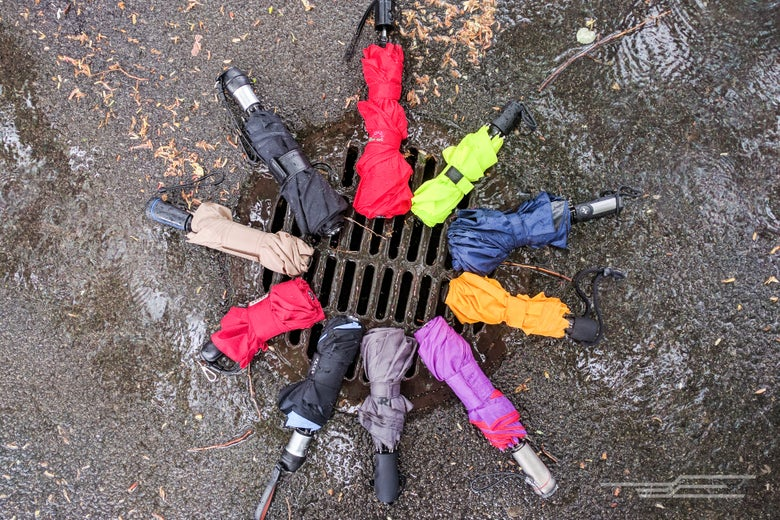 umbrellas around a sewer