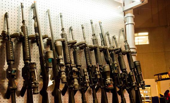 A wall of semi-automatic rifles is seen at the National Rifle Association.