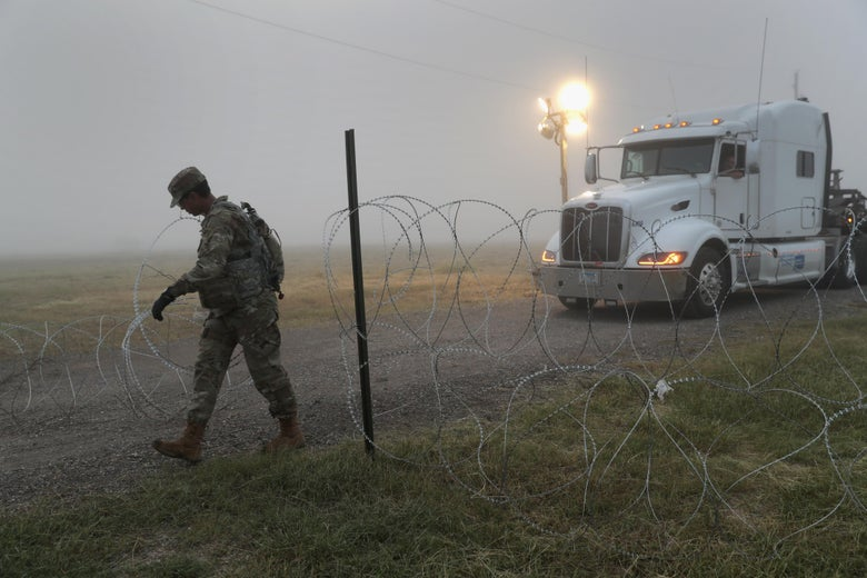 A soldier in Donna, Texas, moving barbed wire near the U.S.-Mexico border.