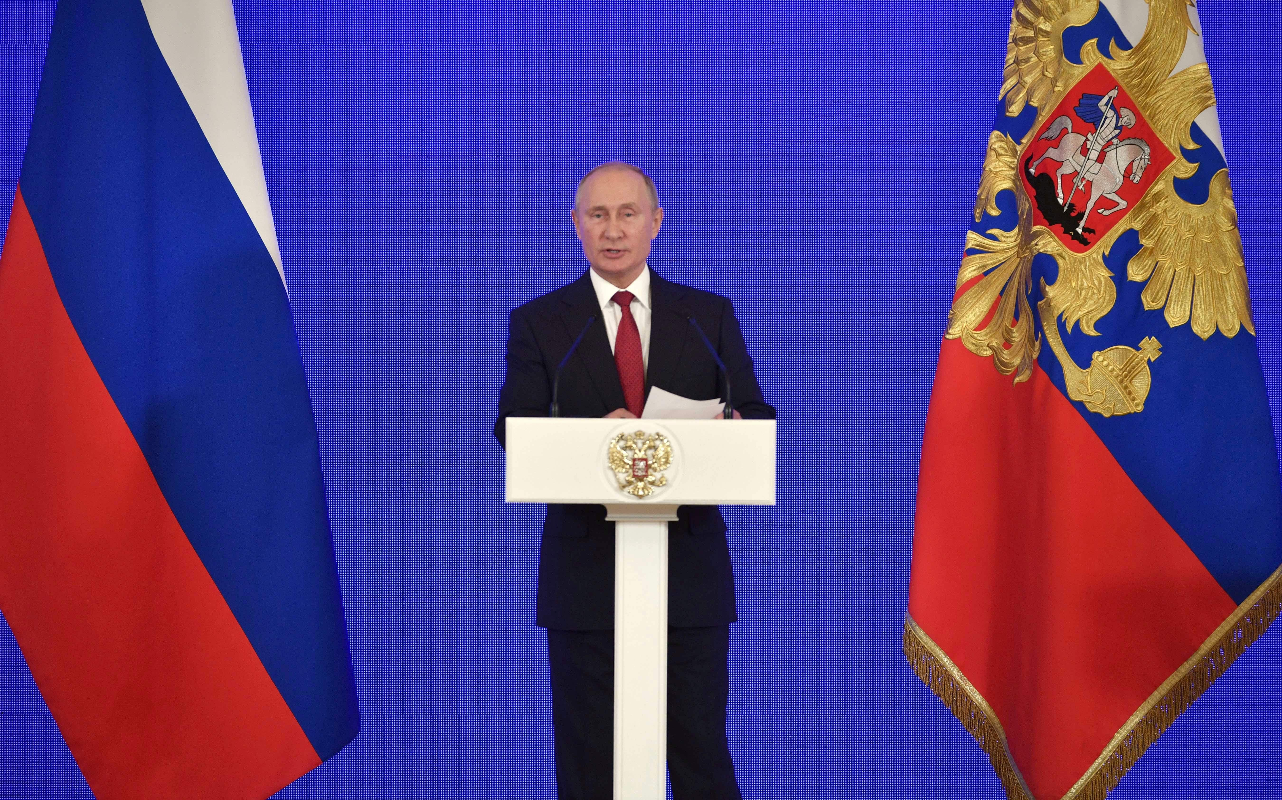 Russia's President Vladimir Putin delivers a speech during a reception in Moscow on November 4, 2018, as a part of celebrations marking Russian National Unity Day.