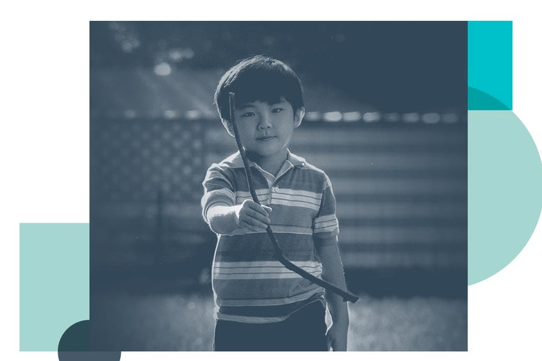 A young boy holding a dowsing rod, from Minari.
