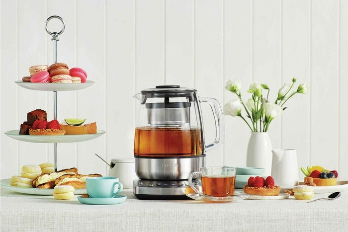 Breville kettle amidst other tea foods.