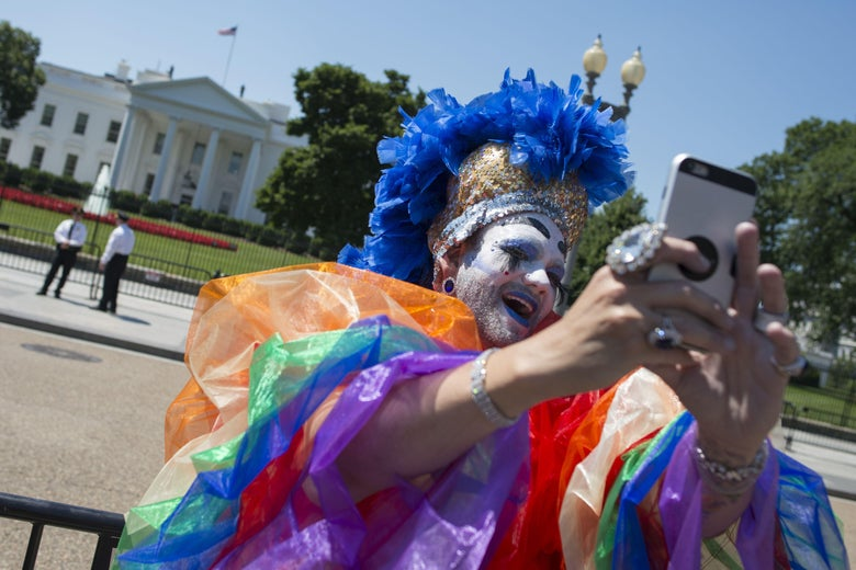 A Drag Queen takes a photo as LGBT members and their supporters walk past the White House during the Equality March for Unity & Pride parade in Washington DC, June 11, 2017. / AFP PHOTO / Andrew CABALLERO-REYNOLDS        (Photo credit should read ANDREW CABALLERO-REYNOLDS/AFP/Getty Images)
