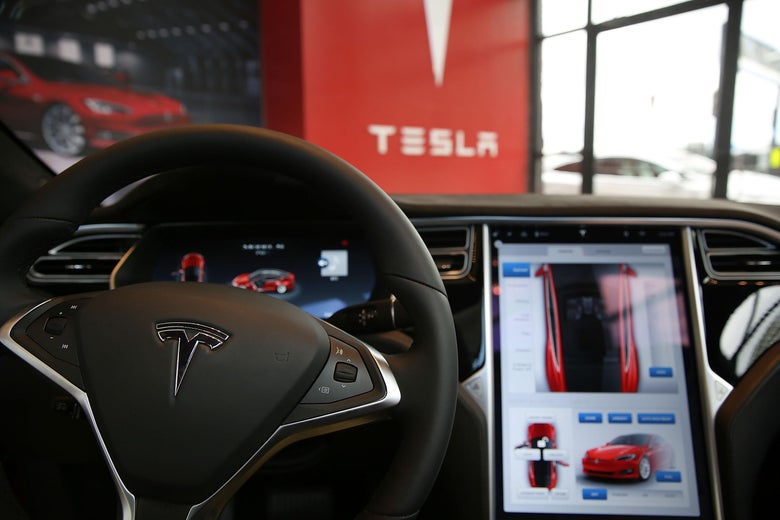 The inside of a Tesla vehicle as it sits parked in a new Tesla showroom.