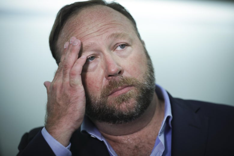 Jones was reportedly banned for a video in which he repeatedly insulted CNN reporter Oliver Darcy.
