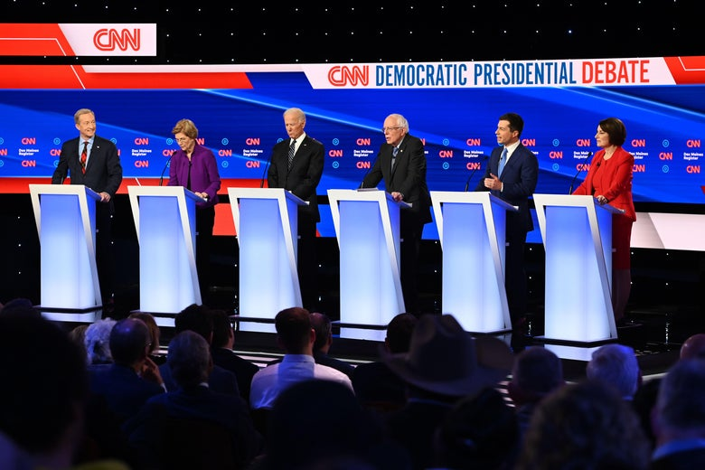 The Democratic candidates stand behind podiums on the debate stage.