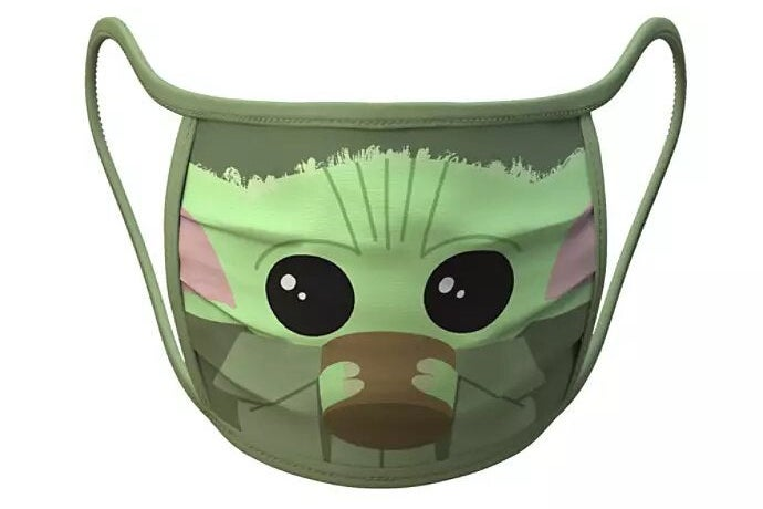A face mask featuring a cartoonish picture of Baby Yoda drinking from a cup.