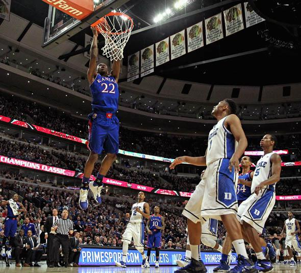 Andrew Wiggins #22 of the Kansas Jayhawks dunks over Jabari Parker #1 of the Duke Blue Devils during the State Farm Champions Classic at the United Center on November 12, 2013 in Chicago, Illinois. Kansas defeated Duke 94-83.
