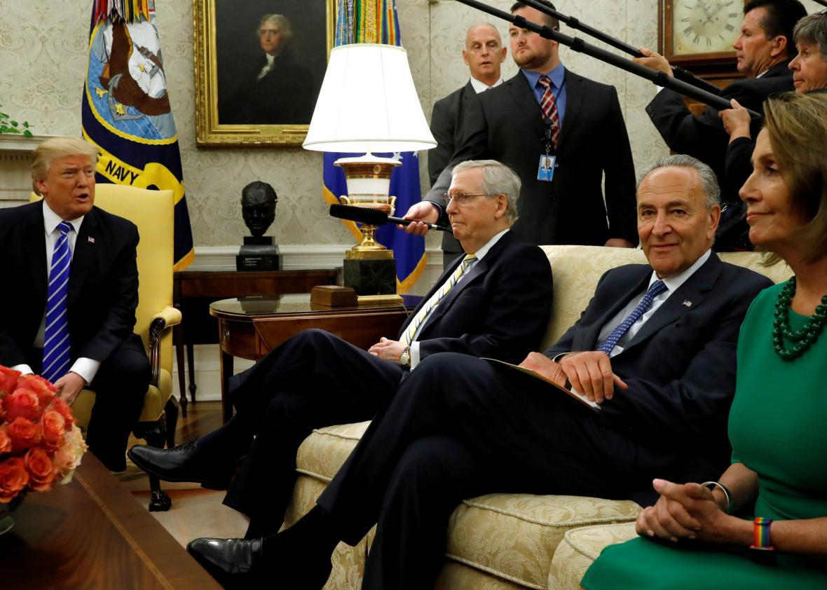 U.S. President Donald Trump meets with Senate Majority Leader Mitch McConnell (2nd L), U.S. Senate Democratic Leader Chuck Schumer (2nd R), House Minority Leader Nancy Pelosi (R).