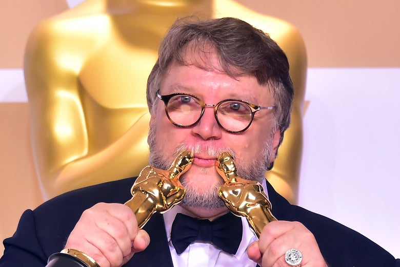 TOPSHOT - Director Guillermo del Toro poses in the press room with the Oscars for best picture and best director during the 90th Annual Academy Awards on March 4, 2018, in Hollywood, California.  / AFP PHOTO / FREDERIC J. BROWN        (Photo credit should read FREDERIC J. BROWN/AFP/Getty Images)