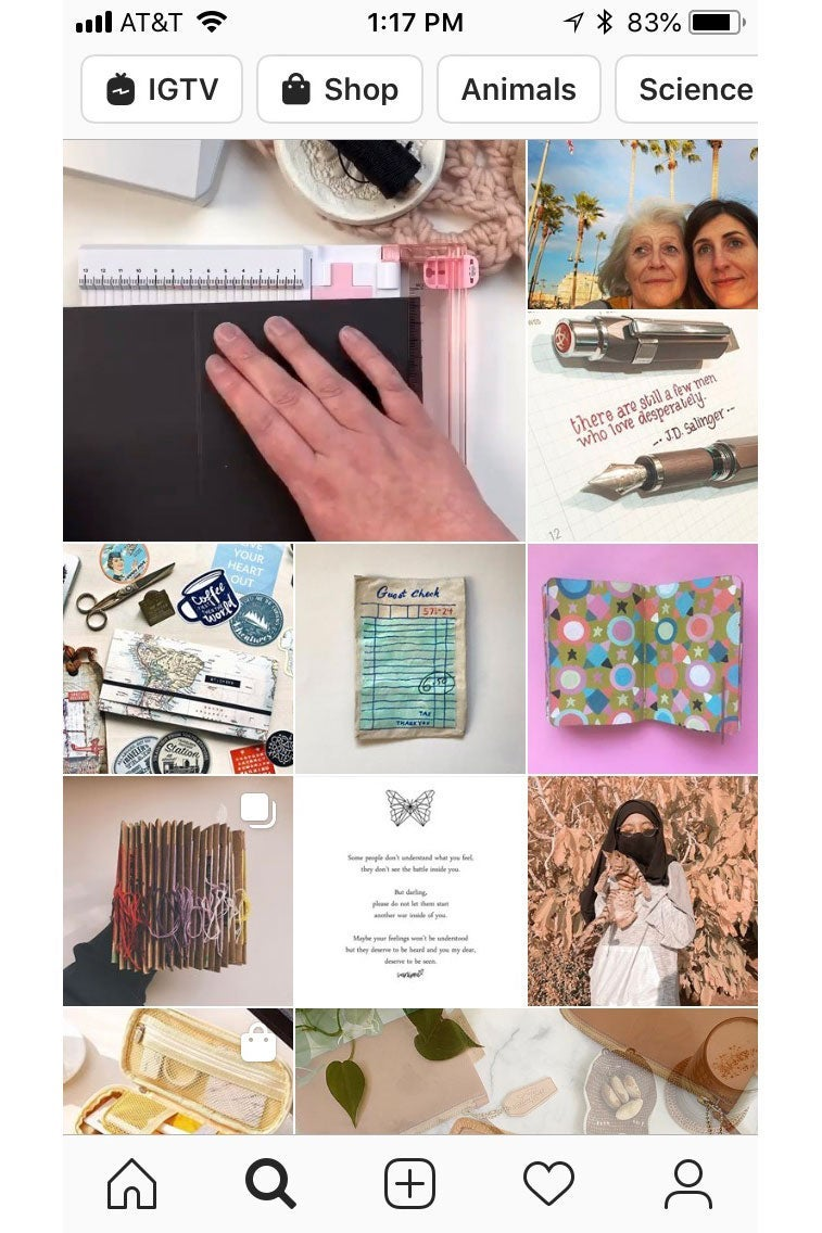 Screenshot of an Instagram Explore feed, featuring photos of pens and paper crafts.