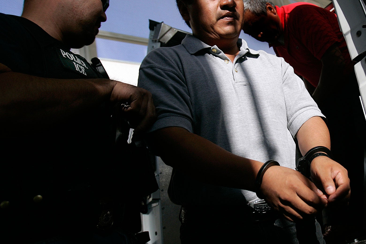 An Immigration and Customs Enforcement (ICE) Fugitive Operations Team member processes an arrest at the ICE Santa Ana Staging Facility in Santa Ana.